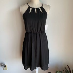 Attention black dress with cutouts at neckline